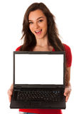 Beautiful young business woman showing laptop with screen for co Royalty Free Stock Image