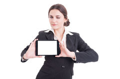 Beautiful young business woman showing tablet with blank display Royalty Free Stock Image