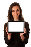 Beautiful young business woman showing tablet with screen for co Royalty Free Stock Photos