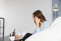 Beautiful young business woman sitting on a couch stock photos