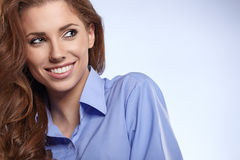 Beautiful young business woman standing against bl Stock Photography