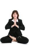 Beautiful Young Business Woman In Suit Meditating. Beautiful young woman in suit meditating. Shot in studio over white Stock Image