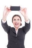 Beautiful young business woman taking a selfie using smartphone Royalty Free Stock Image