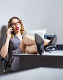 Beautiful young business woman talking on the phone Royalty Free Stock Photos