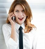 Beautiful young business woman talking on the phone Royalty Free Stock Photography