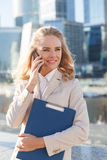 Beautiful young business woman talking on smartphone and happy smiling Stock Photos