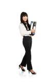 Beautiful young business woman walking Stock Photography
