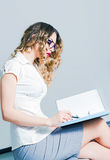 Beautiful young business woman working with documents Stock Photo