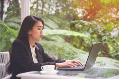 Beautiful young business woman working with laptop ,looking screen With gesture of rejoicing, shock, surprise emotion Royalty Free Stock Images