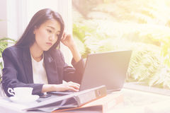 Beautiful young business woman working with laptop ,Thinking Planning about solution Stock Photos