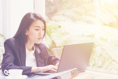 Beautiful young business woman working with laptop ,Thinking Planning about solution Royalty Free Stock Image