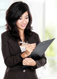Beautiful young business woman working Stock Image