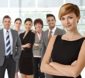 Beautiful young businesswoman and business team Stock Photography
