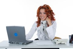 Beautiful young businesswoman calling Stock Images