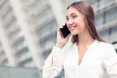 Beautiful young businesswoman is communicating on Stock Image