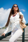 Beautiful young businesswoman with a disposable coffee cup Stock Images