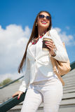 Beautiful young businesswoman with a disposable coffee cup Royalty Free Stock Image