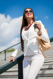 Beautiful young businesswoman with a disposable coffee cup Stock Photos