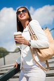 Beautiful young businesswoman with a disposable coffee cup Stock Photo