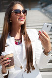 Beautiful young businesswoman with a disposable coffee cup Royalty Free Stock Photo