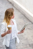 Beautiful young businesswoman with a disposable coffee cup Royalty Free Stock Images