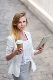 Beautiful young businesswoman with a disposable coffee cup Stock Image