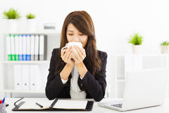 Beautiful young businesswoman drinking coffee in office Royalty Free Stock Photo