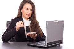 Beautiful young businesswoman drinking coffee / tea Stock Image
