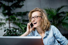 Beautiful young businesswoman having good time and laughing Royalty Free Stock Photo