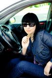 Beautiful young businesswoman in her car stock images