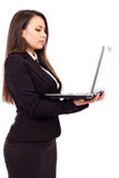 Beautiful young businesswoman holding a laptop Stock Images