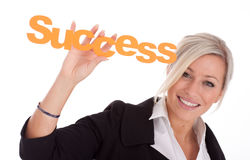 Beautiful young businesswoman holds success Royalty Free Stock Photos