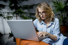 Beautiful young businesswoman laptop in office, focused, trying solve problem Royalty Free Stock Images