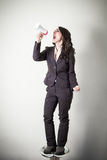 Beautiful young businesswoman with little megaphone Stock Image