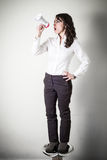 Beautiful young businesswoman with little megaphone Royalty Free Stock Photo