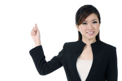 Beautiful young businesswoman pointing Stock Photography