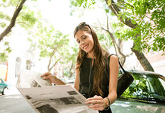 Businesswoman reading paper. Royalty Free Stock Photos