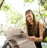 Businesswoman reading paper. Stock Photos