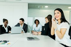 Beautiful young businesswoman receiving good news on the phone s Stock Images