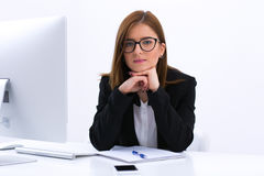 Beautiful young businesswoman sitting at her Royalty Free Stock Image