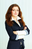 Beautiful young businesswoman standing with arms folded Royalty Free Stock Photo