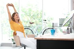 Beautiful young businesswoman stretching stock photography