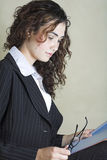 Beautiful young businesswoman in striped suit stock photography