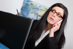 Beautiful young businesswoman talking Royalty Free Stock Photos