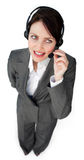 Beautiful young businesswoman talking on a headset Stock Photo