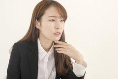 Beautiful young businesswoman thinking Royalty Free Stock Image