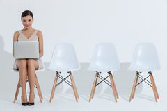 Beautiful young businesswoman is typing on notebook Royalty Free Stock Photos