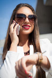 Beautiful young businesswoman using cell phone Royalty Free Stock Image