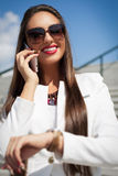 Beautiful young businesswoman using cell phone Stock Images