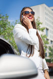 Beautiful young businesswoman using cell phone Royalty Free Stock Photos